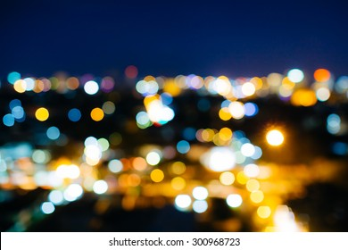 a blur bokeh picture of Chiang mai,Thailand cityscape at night time.