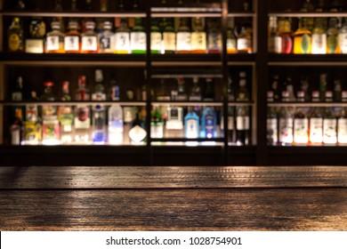 blur bottle of alcohol drink at club pub or bar in dark party night background