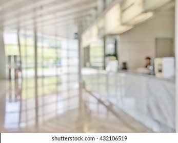 Blur business background bank reception hall customer or patient counter service and cashier desk inside hospital, office or hotel