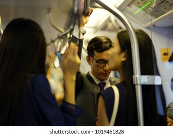 Blur: The business man and woman travel by subway train in the morning time.