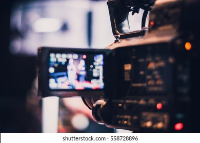 Blur of camcorder while filming. - Shutterstock ID 558728896