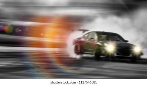 Blur of Car drifting, Sport car wheel drifting and smoking on blurred background.