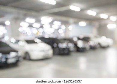 Blur of car in the car parking with light and bokeh background