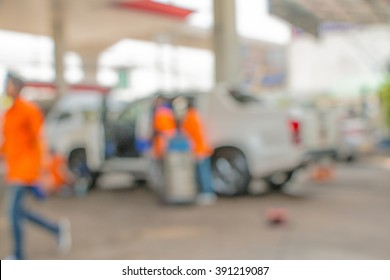 Blur car wash several employees are working.