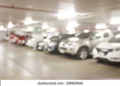 blur cars parking with bokeh light Background for use as Background