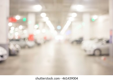 blur cars parking with bokeh light Background for use as Background.