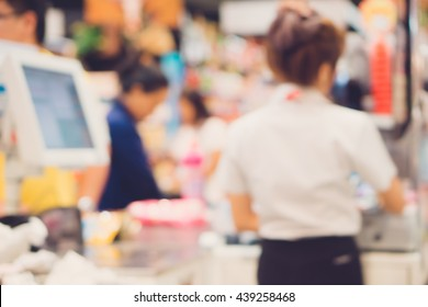Blur cashier counter in the supermarket,Cashier at a supermarket checkout in a department store.Vintage tone.