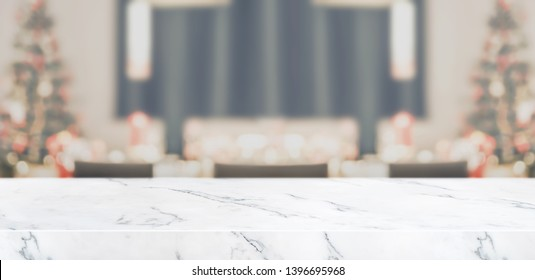Blur christmas tree decoration at kitchen table with marble table top living room  background with bokeh light,Holiday backdrop,Mock up banner for display of product