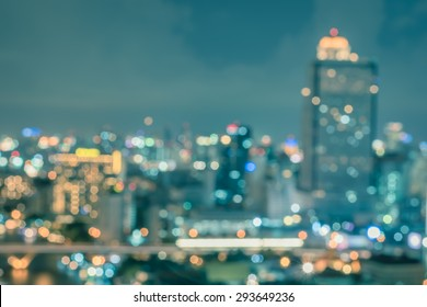 Blur city background rooftop view cityscape business building landscape night lights bokeh in cool vintage style