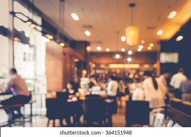 Blur coffee shop  or cafe restaurant with abstract bokeh light image background.For montage product display or design key visual layout