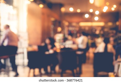 Blur coffee shop  or cafe restaurant with businessman   background. For create  montage product display