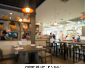 Blur coffee shop or cafe restaurant with abstract bokeh light background