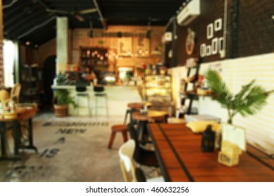 Blur coffee shop or cafe restaurant with abstract bokeh light image background. For create montage product display. Abstract blur coffee shop background - vintage filter effect.