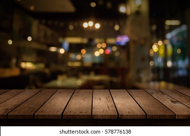 Blur coffee shop or cafe restaurant with abstract bokeh light background. For create montage product display