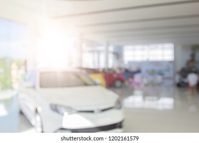 Blur colorful showroom a row of new cars parked at a car dealership stock customers to view and buy. Blurred in workplace abstract background of shallow depth of field for sale background use.