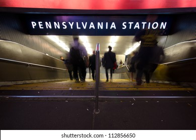 Blur of commuters rushing down the steps to Pennsylvania Station subway in New York City