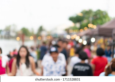 Blur the country river evening market Thai style with people relax and chill out bokeh background.