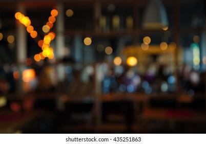 blur dark bar or cafe at night
