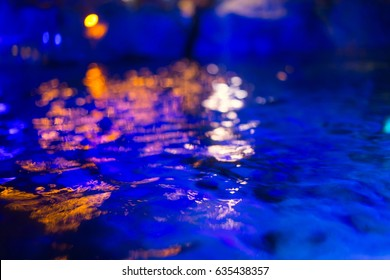 Blur Dark blue water pool moon. deep sea reflect in night time for background.