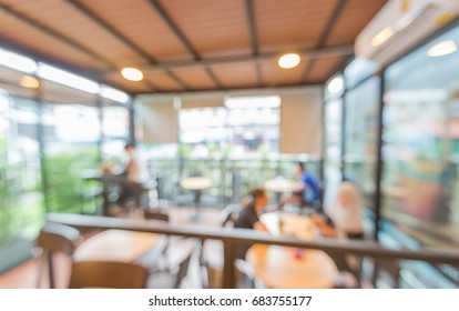 Blur or Defocus image of Coffee Shop or Cafeteria for use as Background.work, read and get together.