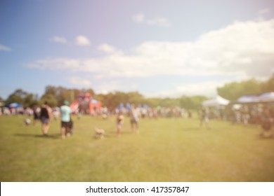 Blur defocused background of people and dog in park fair, summer festival, retro tone