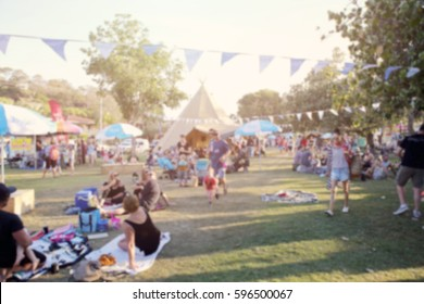 Blur defocused background of people, family in park fair, festive summer, music festival tent - Shutterstock ID 596500067