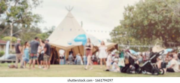 Blur defocused background of people in park fair, summer music festival, family outdoors, festive fair,  festival tent