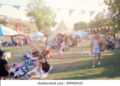 Blur defocused background of people in park fair, summer festival, retro tone