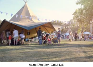 Blur defocused background of people in park fair, summer festival, toning