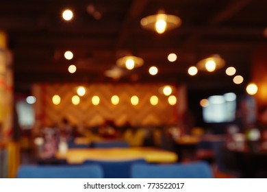 Blur defocused interior of restaurant or cafe with bokeh for background usage