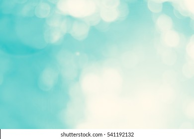 Blur dream cool bokeh grass in morning sunny day nature background concept csr modern life, eco spring, summer friday happy easter, fresh bio green texture. Abstract clean blue cyan shade wallpaper.