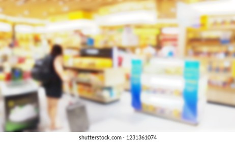 Blur of duty free shop at airport with passengers are walking shopping. A passenger in the duty free shop at the airport. Blur effect.