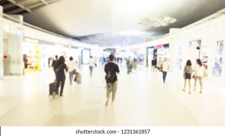 Blur of duty free shop at airport with passengers are walking shopping. People in the duty free shop at the airport. Blur effect.