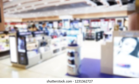 Blur of duty free shop at airport. Blur shop cosmatics and skincare in Department store. Blurred image of cosmetic shop. Cosmetic shop background.