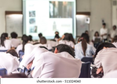 Blur education background lazy student audiences in lecture hall sleepy studying, feeling tired sleeping on school desk