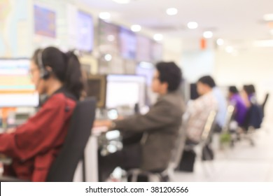 blur employee work as call centre talking with customer at operation monitor room concept.