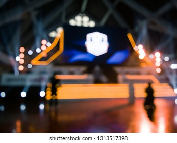 Blur Esport tournament/competition stage with computer and gamer on stage and decoration light reveals colorful bokeh
