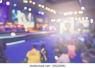 blur event with people background -  blurred computer game show festival  bokeh light vintage tone - business concept