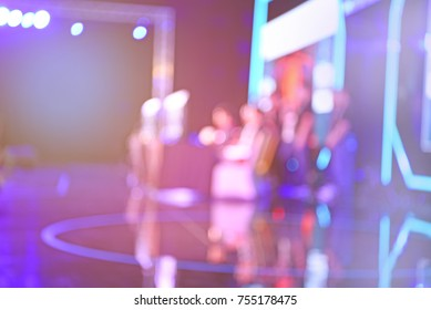 blur event with people background - blurred computer game show festival bokeh light vintage tone - people and activity on stage -  business concept