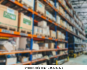 Blur factory warehouse storage with packaging box inventory for abstract background concept design
