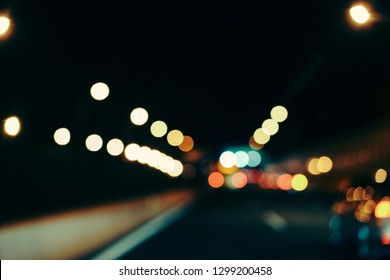 Blur focused urban abstract texture bokeh city lights & traffic jams. Looking out from the windshield of the car cab.