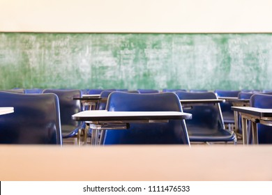 blur focus.front view abstract background of examination room with undergraduate students inside. university student in uniform sitting on lecture chair taking final exam or study in classroom.