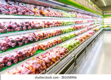 Blur of fresh fruits on shelf in supermarket.For healthy concept