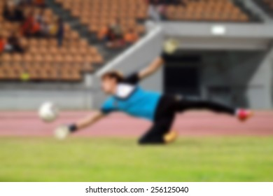blur Goalkeeper with ball in action and warm up for background