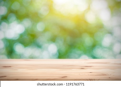 Blur green with wooden table space for products display montage background