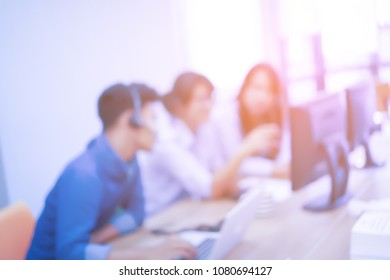 blur group of call center ethnics employee working at operation room and consulting together about resolve case , teamwork concept