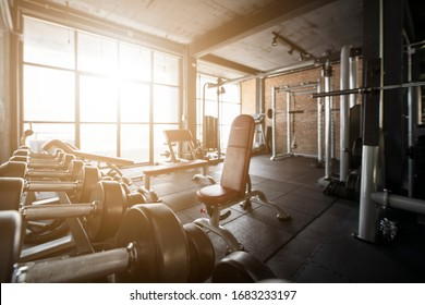 Blur Gym background concept with workout weight equipment in Fitness