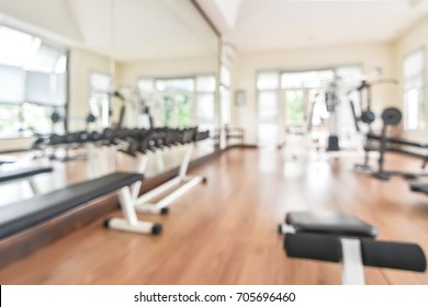 Blur gym background fitness center or health club with blurry sports exercise equipment for aerobic workout and bodybuilding