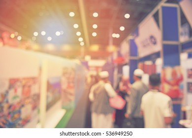 blur Halal conference assembly - blurred event with people background - participants enjoy booth products
