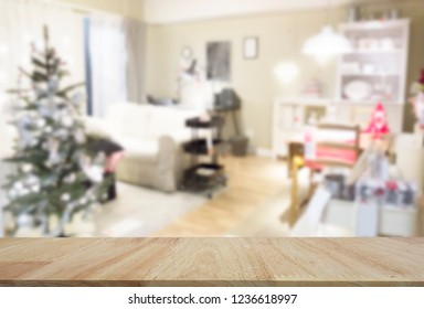 Blur Home Concept : OAK wood Table top for product display with background. Merry Christmas and Happy Holidays! A beautiful living room decorated for Christmas. Beautiful holiday decorated room with C